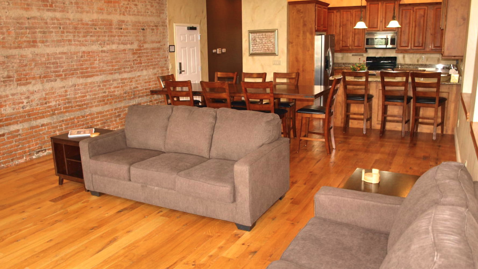 A large suite at cornerstone Inn featuring a kitchen, dining area, and living space.